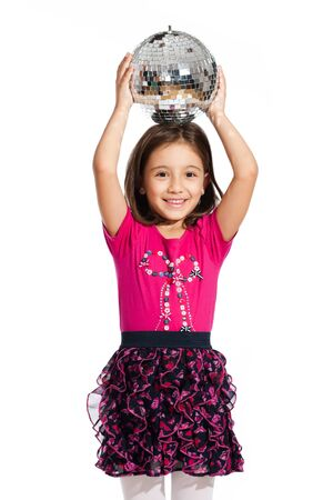 lovely little girl, playing with a disco ball, isolated on white background photo