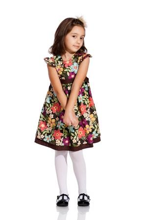 zapatos escolares: ni�a bonita, con un vestido de color hermoso, aisladas sobre fondo blanco Foto de archivo