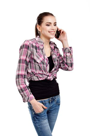 teen girl brown hair: portrait of a beautiful, teen girl, talking on the phone, isolated on white background Stock Photo