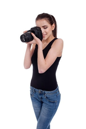 portrait of a beautiful, young woman, taking a photo with her camera, isolated on white background photo