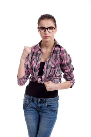 portrait of  a angry, beautiful teen girl, ready to punch, isolated on white background