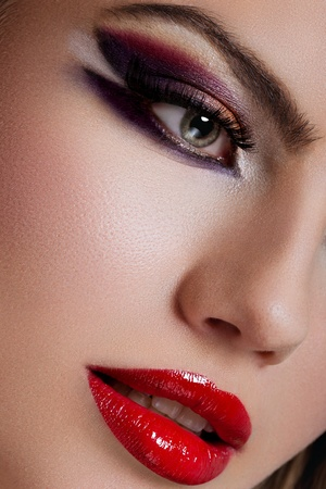 closeup portrait of blonde young woman, with green eyes, full lips and fashion makeup - high end retouching photo