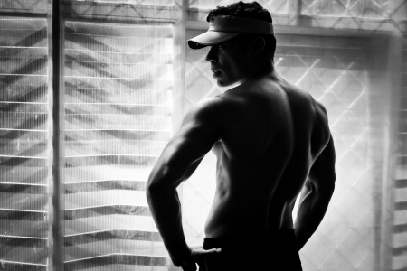 artistic shot, black and white, of a young bodybuilder posing in the gym Stock Photo - 16168182