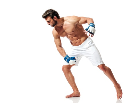 young fit man preparing for fight, muay thai position