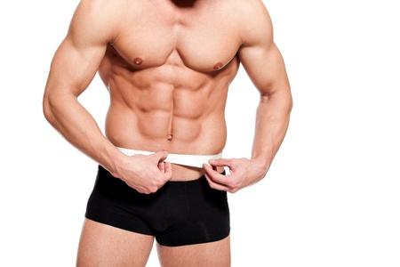 cintura perfecta: fuerte cuerpo joven perfecto de un hombre destinado para esto, midiendo con cent�metro