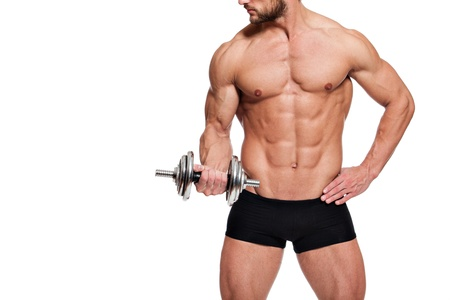 muscular body: young fit man holding a dumbbell, on white background