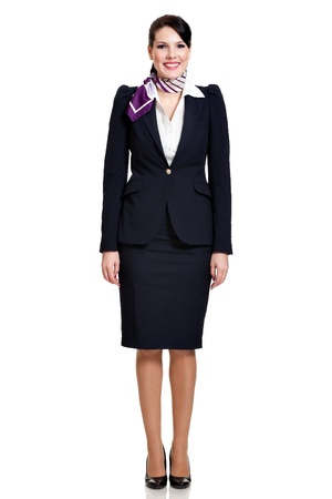 navy blue suit: front side, full body of a beautiful dark haired young business woman dressed in a dark blue suit with a purple scarf smiling, isolated on white background