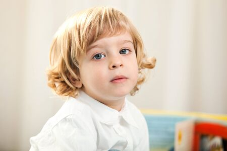 two year old: A serious two year old child  Portrait of a blonde two year old boy