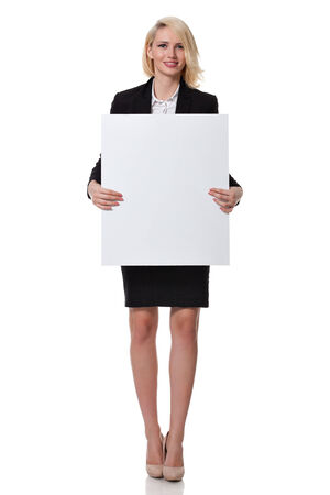 full length of a beautiful young blonde woman standing and holding a board in front of her photo