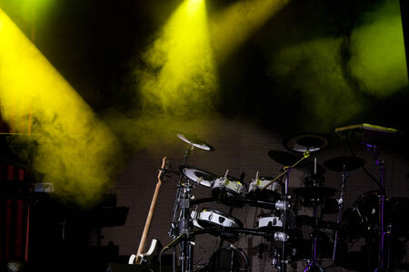 reflectors: Drum on a dark stage with reflectors showing the smoke Stock Photo
