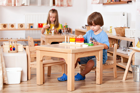 Child playing with toys at his table  ; Image shot from a kindergarten Stock Photo