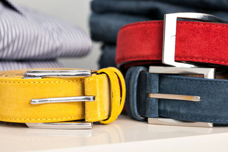 suede belt: Display of bright colored man belts in a shop