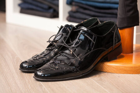 patent leather: Display of a pair of laquered leather man shoes