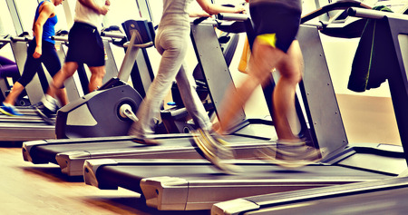 run: retro, vintage gym shot - people running on machines, treadmill Stock Photo