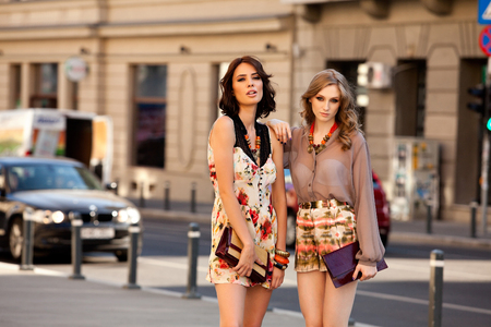 Fashion shot of two elegant beautiful girls in the city. Two young women outdoor on the street. Shopping inspiration Reklamní fotografie