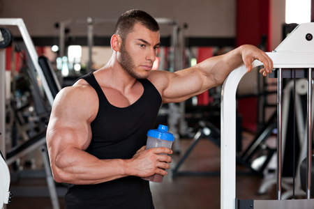 young professional bodybuilder in the gym, drinking a protein shake Reklamní fotografie