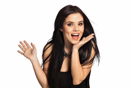 Überrascht Frau Ergebnis geöffnete Hand Palm mit textfreiraum für Produkt oder Text. Wunderschöne, lächelnd weiße kaukasischen weibliche Modell auf weißem Hintergrund. Standard-Bild