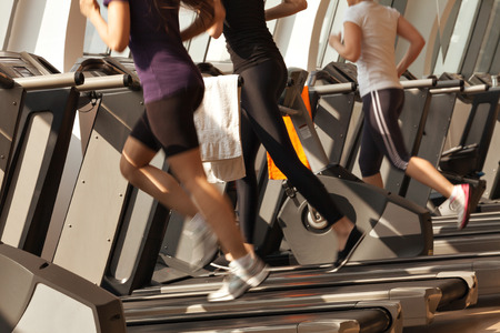 gym girl: gym shot - people running on machines, treadmill