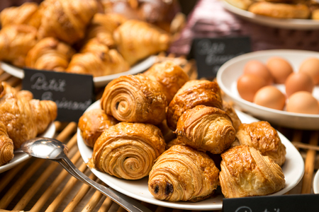 bakery store: croissant plate on the table in a bakery store, ready to be served