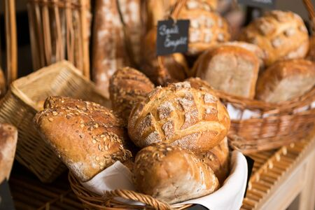 bakery store: baskets of bread on a shelf, in a bakery store Stock Photo