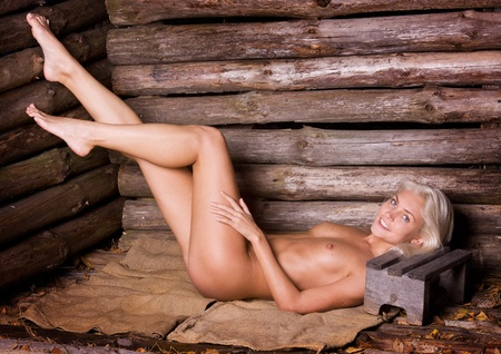 bare breasts: blonde beauty in an old farmhouse.