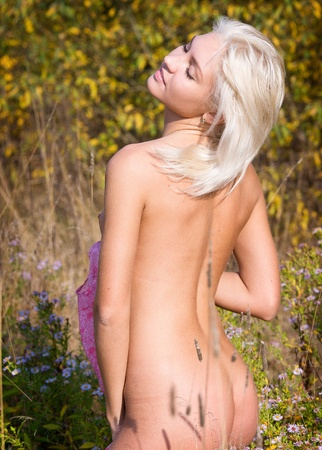 nude outdoors: Nude beauty of flowers.