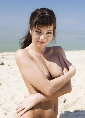 Brunette on a sandy beach.
