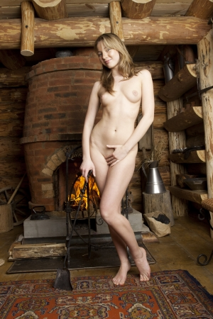 woman nude standing: Beautiful blonde in a farmhouse. Stock Photo