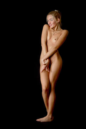 Nude blonde on black background  Stock Photo - 17381066