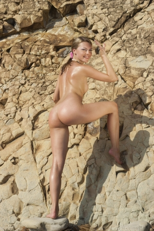 Beautiful nude young woman on the rocks  Stock Photo