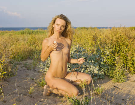 nude young woman on the beach Stock Photo - 15126865