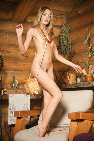 Beautiful topless girl   in a village house