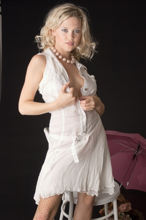 The blonde in a white dress   photo
