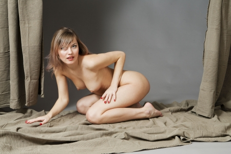 Naked girl in the studio  Portrait of a nude young woman