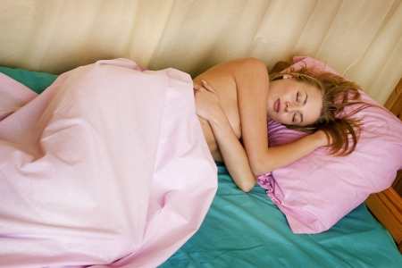 Sleeping young woman  Nude girl in bed  Stock Photo