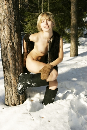 The first snow  Funny naked blonde in the open air  Stock Photo