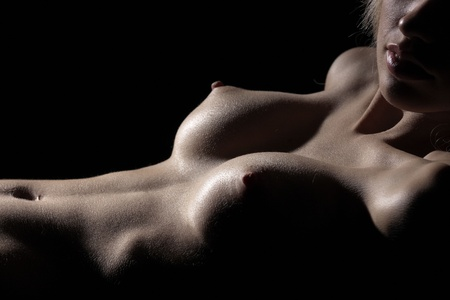 Naked female body on a black background  Stock Photo