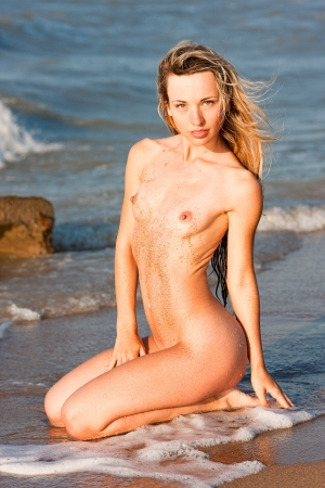 Beautiful nude girl  Naked young woman on the beach  Stock Photo