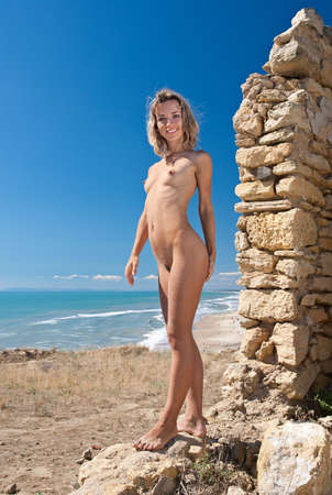 beach breast:   girl standing on the ruins of the old fortress