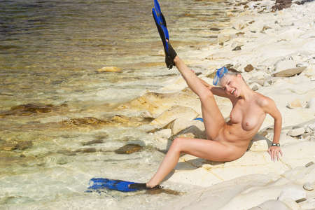 nice breast: Charming   female diver  Rocky beach