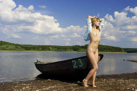 pretty girl on the shore of the lake  Stock Photo