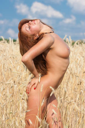 Young naked woman of rye Stock Photo