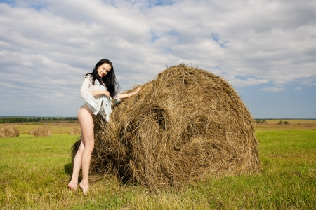 bare body women: young woman near a haystack  Stock Photo