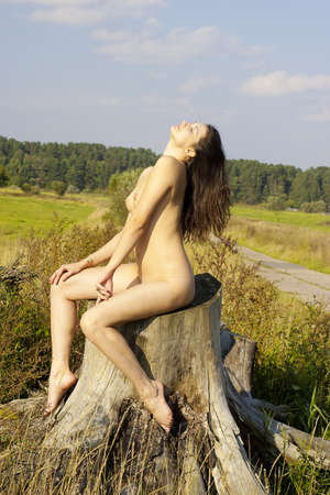 brunette naked: Naked brunette in the open air  Stock Photo