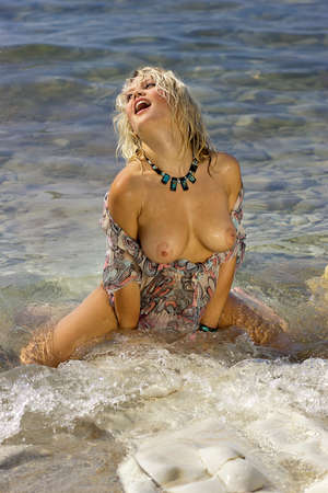 Beautiful nude girl  Naked young woman on the sea