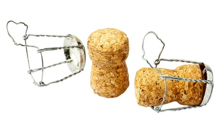 Two champagne corks closeup on white background. Isolated. photo