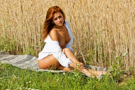 Beautiful nude girl   Young naked woman on a field of rye  photo