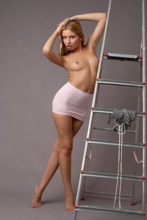 beautiful  nude girl near the stepladder