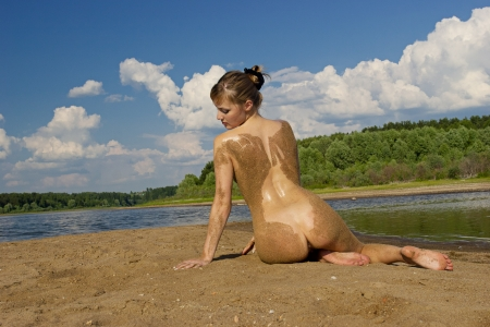 female nudity: Portrait of a nude girl in the open air