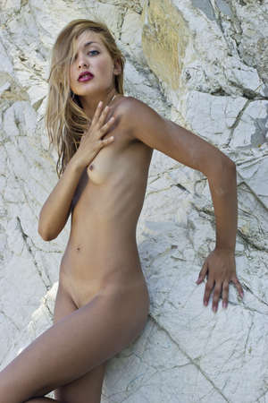 Nude girl near the white cliffs  Beautiful naked woman  Stock Photo